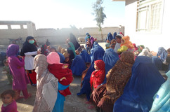 Afghan families waiting to receive services from the Behsood Health Clinic.