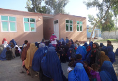 Behsood Health Clinic staff providing an educational overview to patients outside of Maternal & Child Health unit