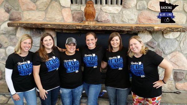 6 smiling police wives wearing their Blue Line tee shirts