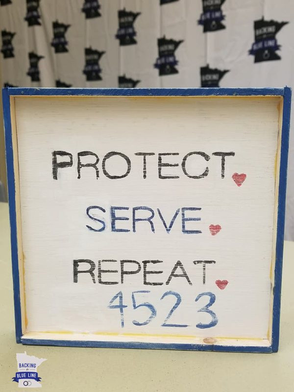 Handpainted craft with the words Protect Serve Repeat badge number 4523