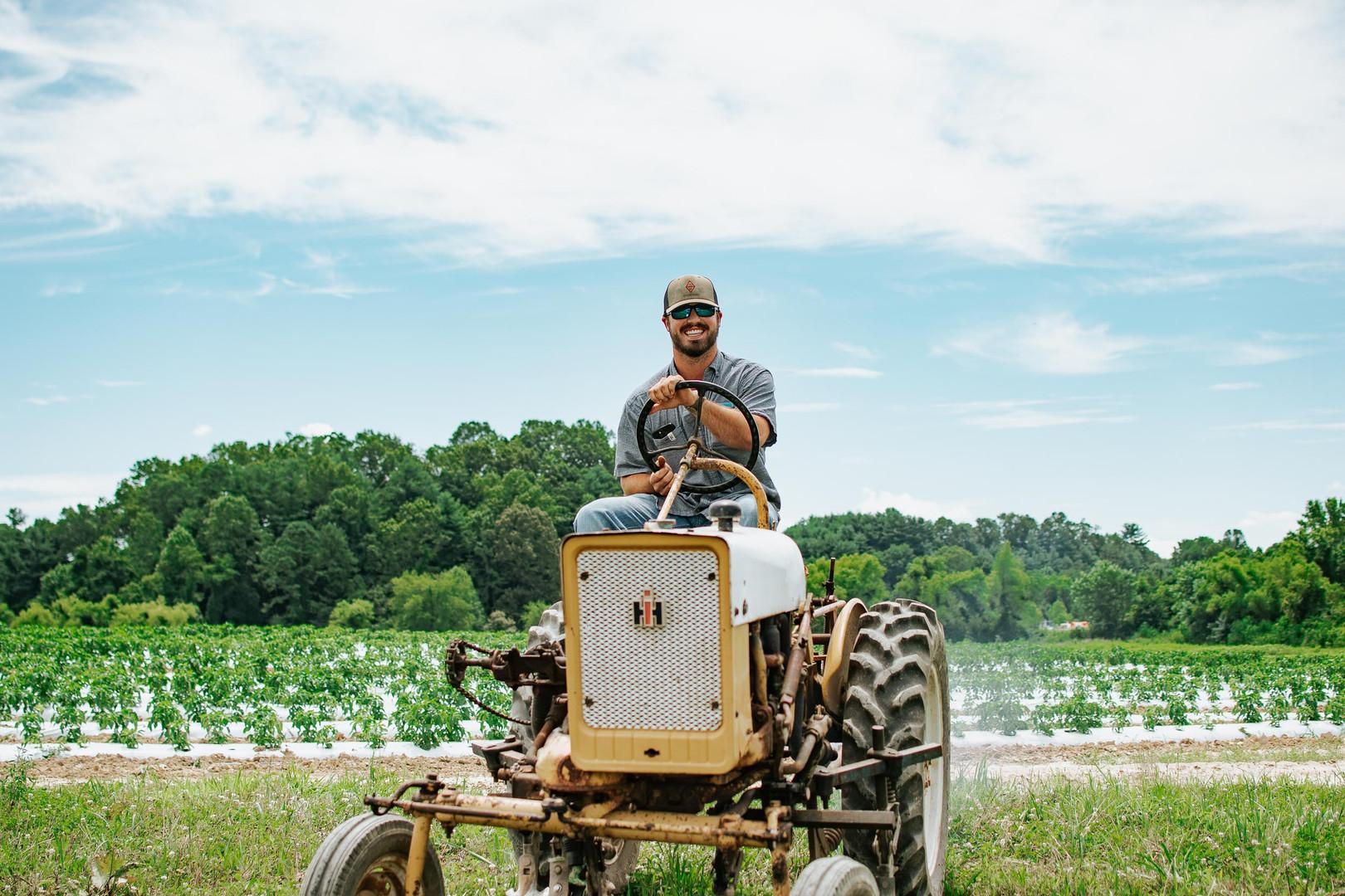 Farmers Alliance_Farmer on Tractor 1.jpg