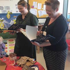 Dolphin teachers receiving books.jpg