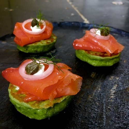 Smoked Salmon on a Pea Blini with horseradish, capers & red onion