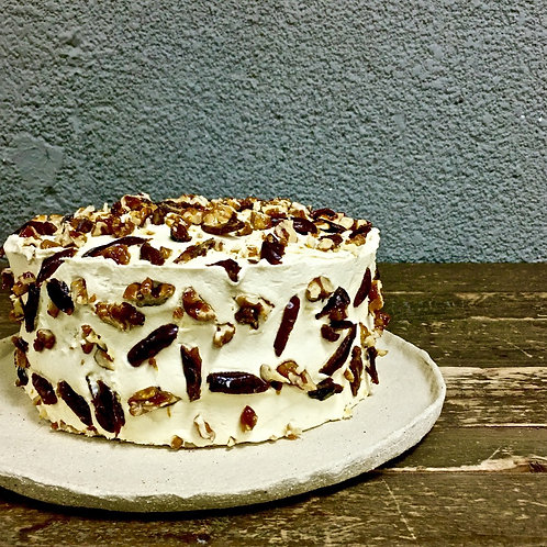 Date Cake with brown butter frosting & crushed walnut praline