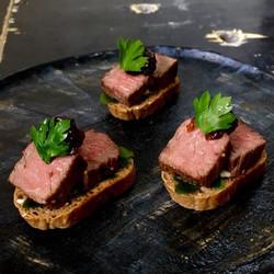 Rare roast beef crostini