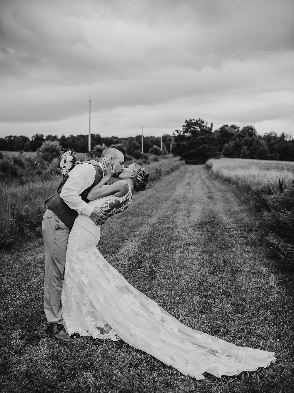 Bride and groom kiss after wedding - Rochester, NY wedding photographer