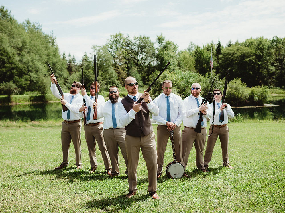 Groomsmen with guns before wedding ceremony in Rochester, NY.