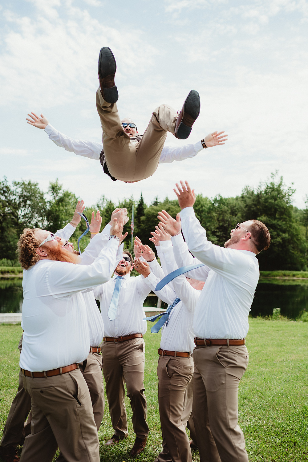 Groomsmen celebrating their friend's wedding.  Wedding Photography in Rochester, NY.