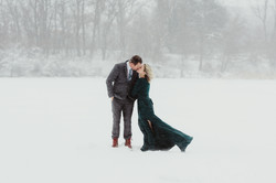 married couple kissing in blizzard