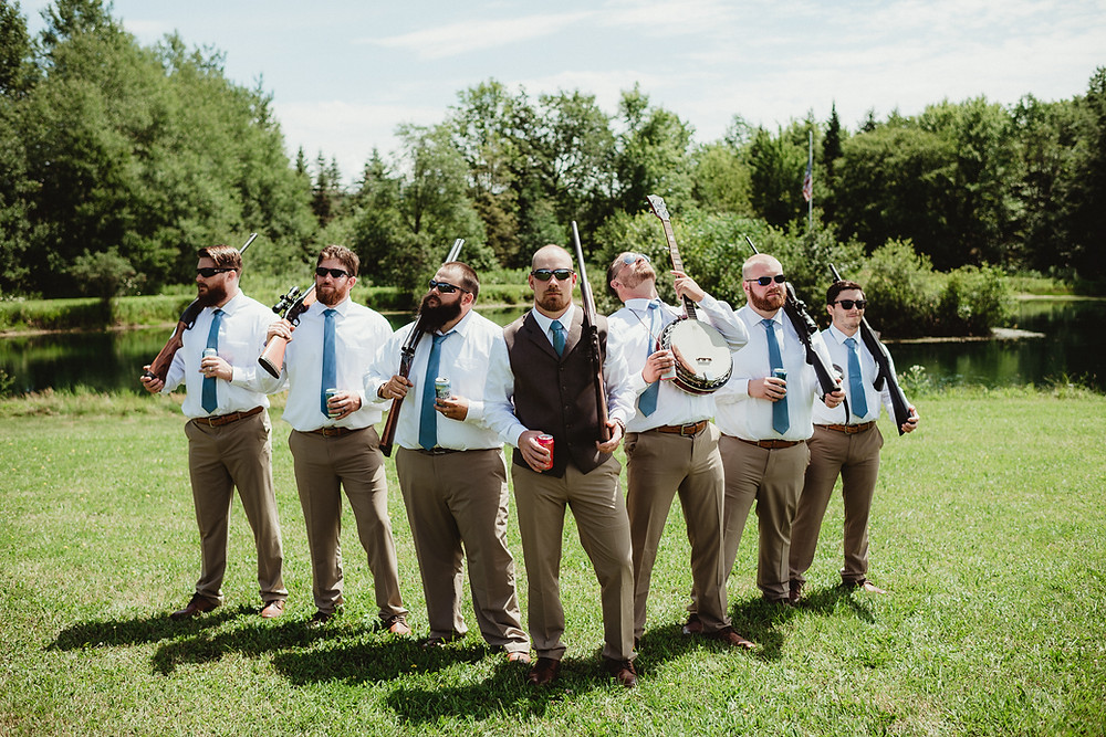Groomsmen with guns before wedding ceremony in Rochester, NY.  Wedding Photography.