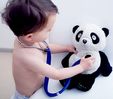 boy with stethoscope and bear