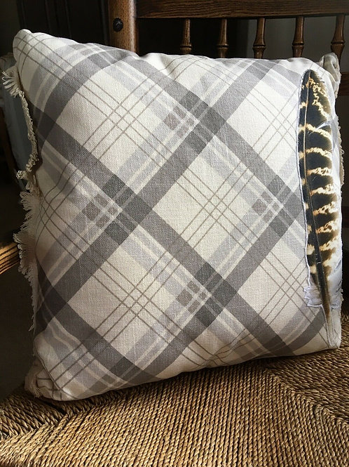 Plaid  cushion with feather design