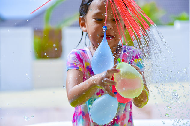 child playing  water balloons..jpg