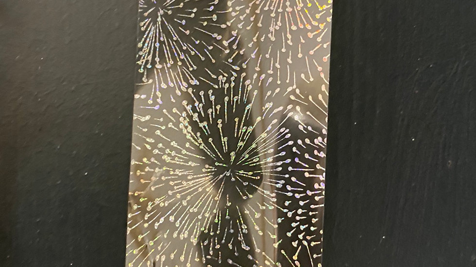 Holographic starburst on clear transfer foil