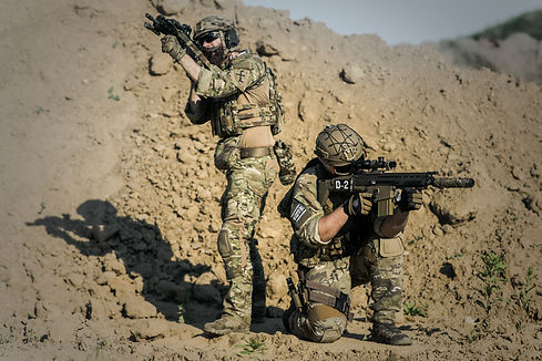 two-men-in-army-uniforms-with-guns-16347