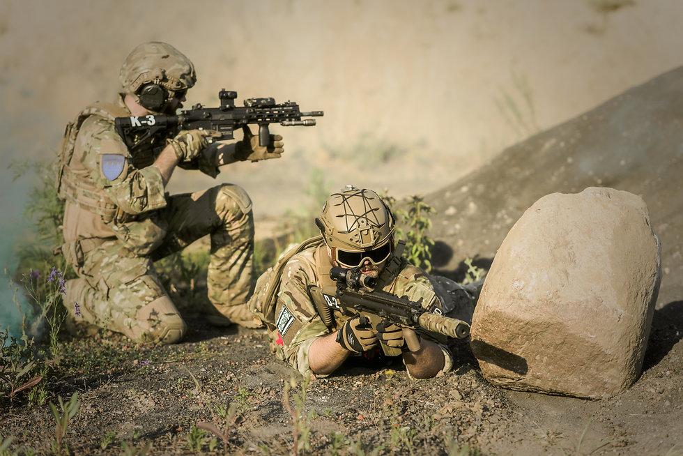 military-sniping-near-rock-163467.jpg