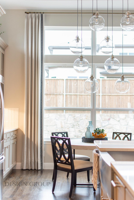 Dining Design with Furniture, Window Treatments, Unique Light Fixture and Colorful Centerpiece Accessories