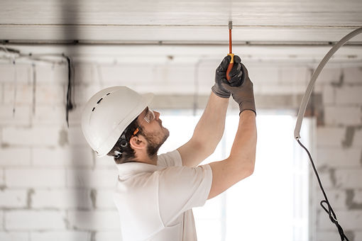 electrician-installer-with-tool-in-his-h