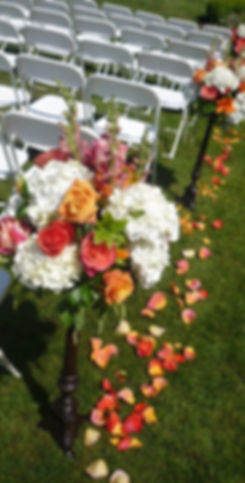 Aisle arrangement roses, hydrangea, snapdragon, lily