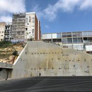 Terrain containment structure of a football field in La Torrassa