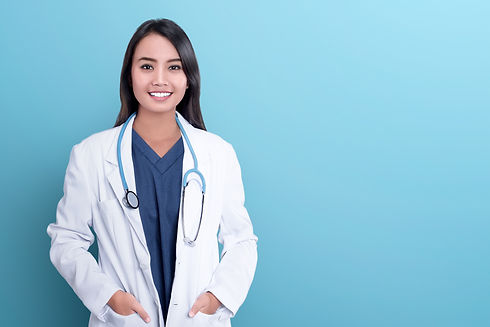 Smiling asian woman physician in a white