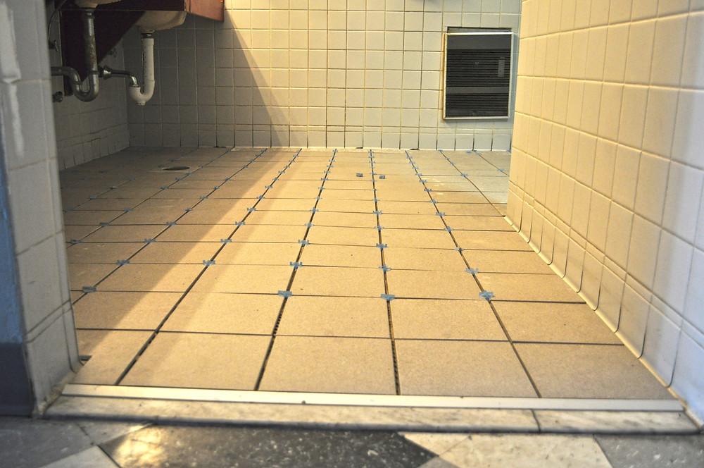 Womens Restroom floor tile before grout