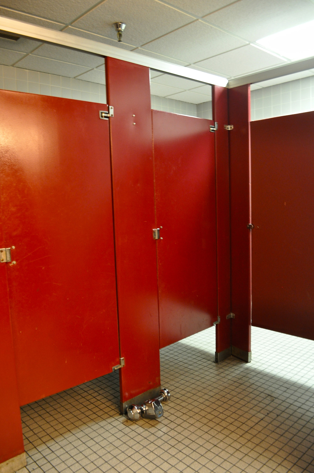 Womens Restroom partitions before