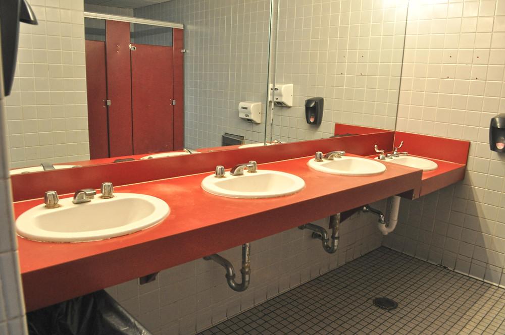Womens Restroom vanity and tile floor before