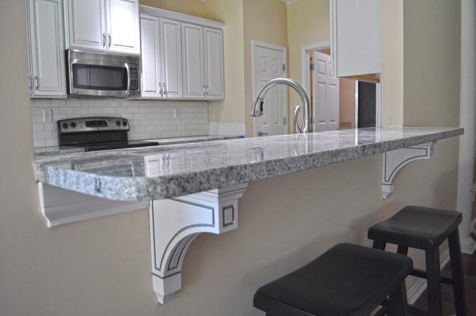 White Kitchen with Hopscotch Pattern Tile