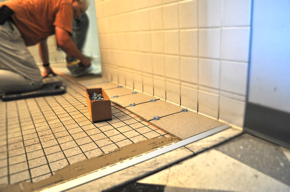 Womens Restroom as new tile floring is being laid