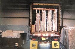 Slab shipment arriving to the shop.