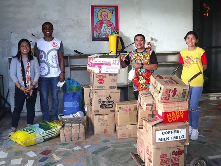 Thomasians Aid Flood Victims in Talisay City