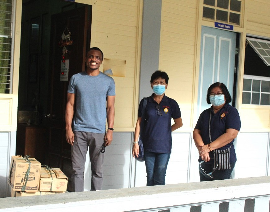 SARF San Carlos City Chapter. Herminia R. Villanueva, SAR (center) and Jean Blanco, SAR (right) drop the SARF donations at CST-R.
