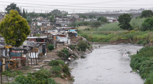 Alexandra township on the banks of the Jukskei River and covered in rubbish