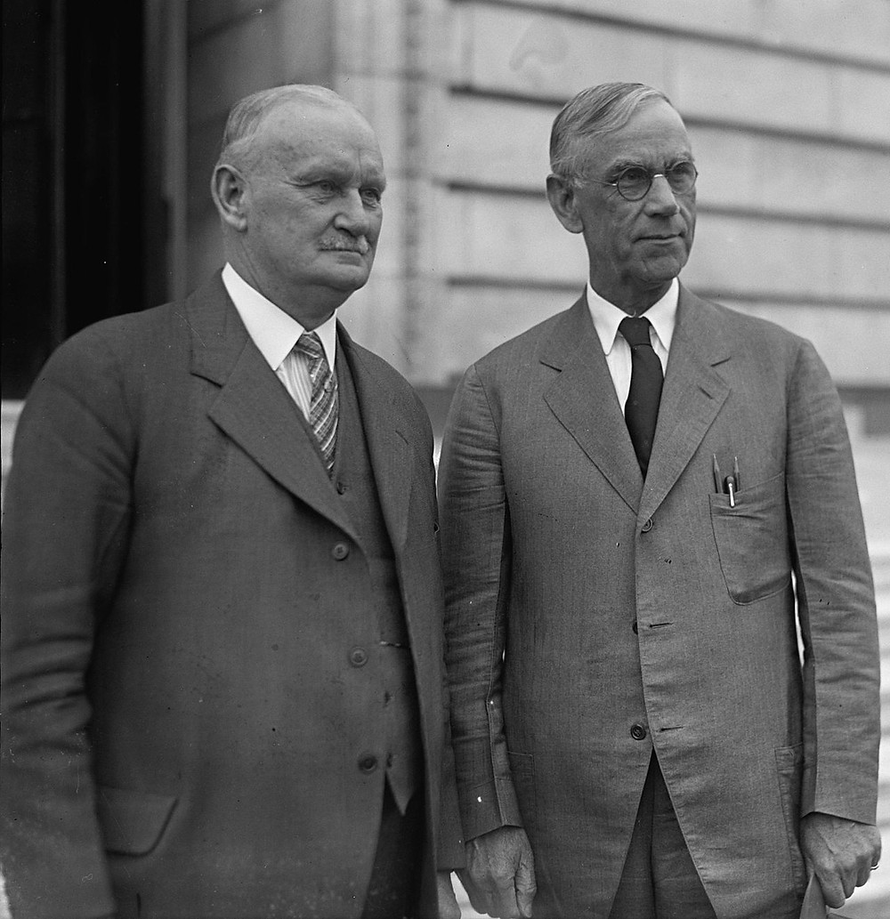 Willis C. Hawley (left) and Reed Smoot in April 1929, shortly before the Smoot–Hawley Tariff Act passed the House of Representatives.