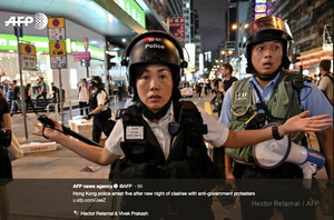 a tweet by the afp shows the police in Hong Song arresting anti China protesters