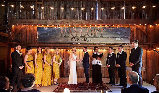 A wedding party witnessing a wedding ceremony at the Hayloft Dancehall