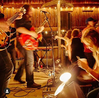 A band playing live music to a dancing audience at the Hayloft Dancehall.
