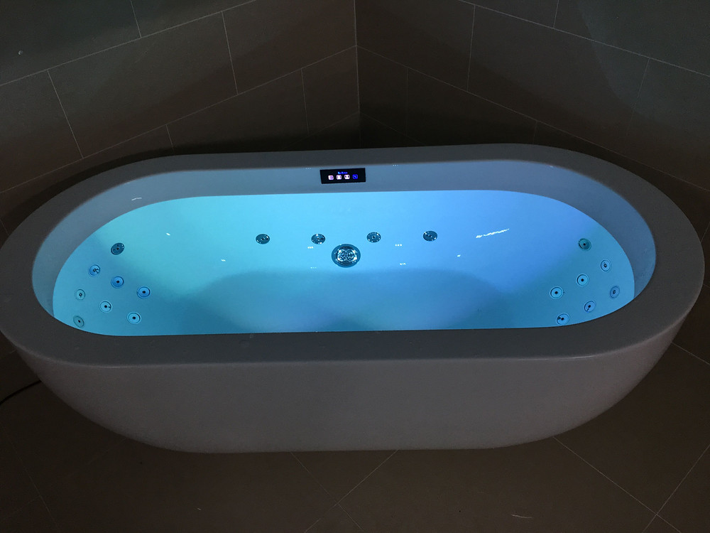 White whirlpool bath with LED lights