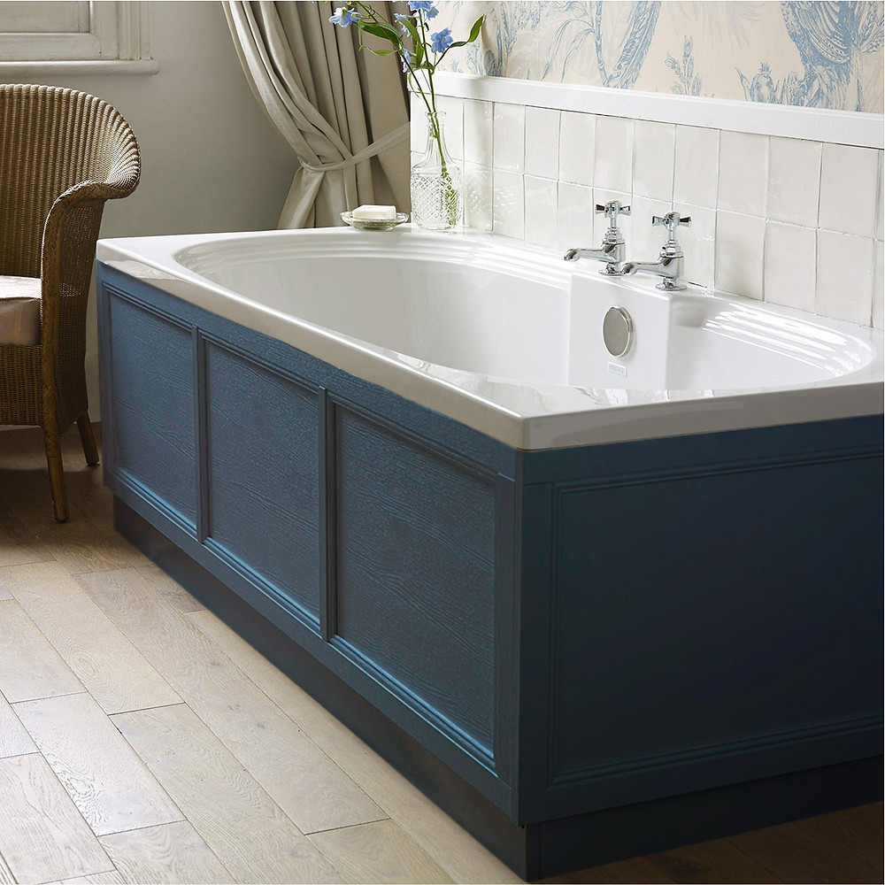 Inset bath with blue bath paneling and chrome fixtures