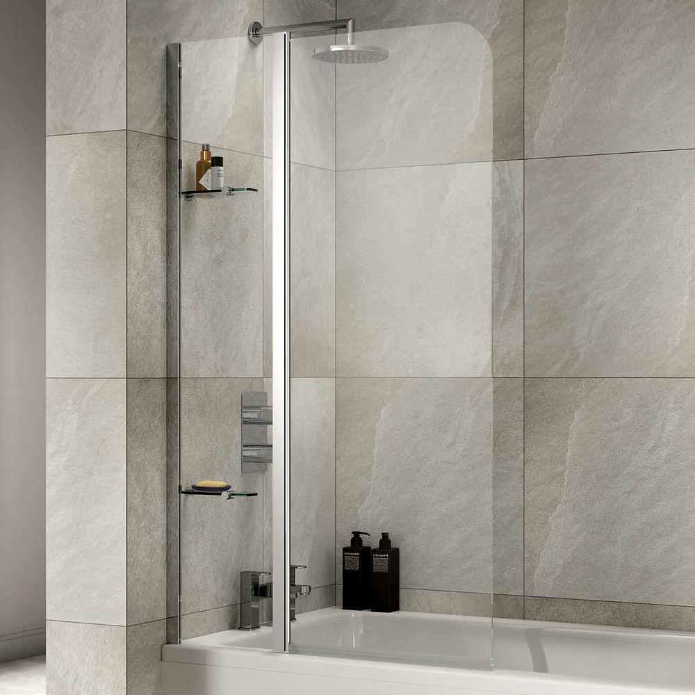Curved top bath screen in tiled bathroom