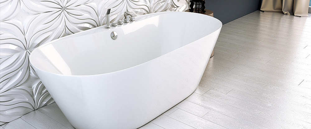 White freestanding bath with chrome fixtures in centre five holes