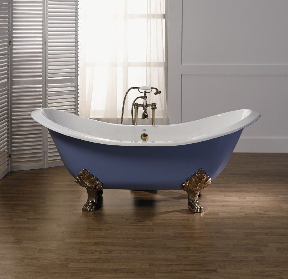 Freestanding blue bath with ornate golden bath feet