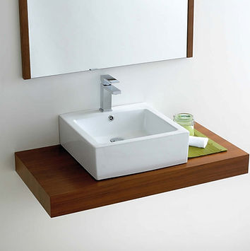 white bathroom basin with chrome tap on wooden countertop