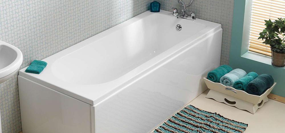 White inset bath with chrome taps