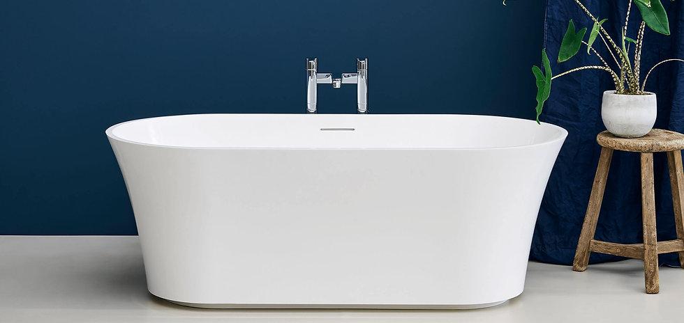 white freestanding bath with chrome freestanding taps