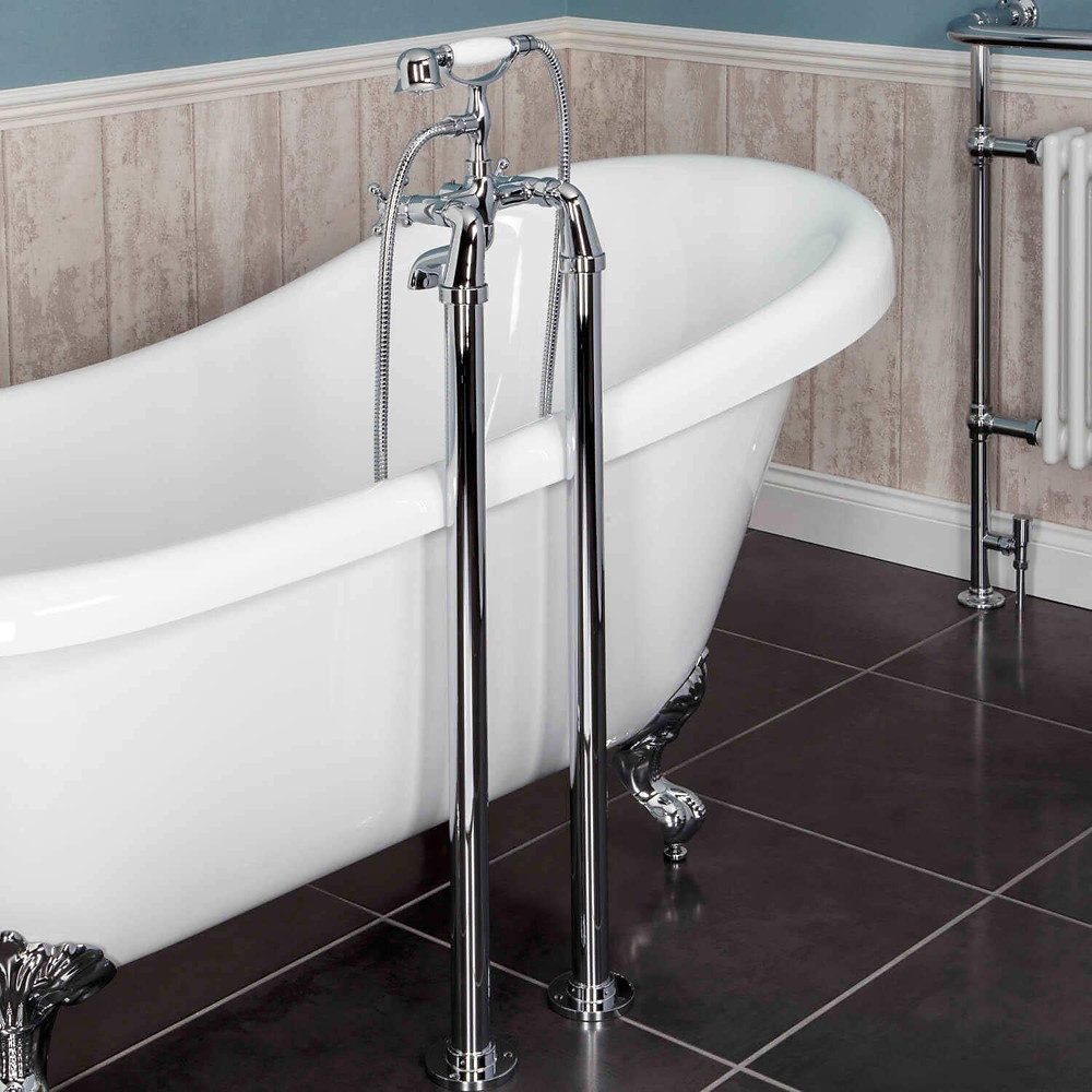 White roll top freestanding bath with chrome freestanding taps, standpipe, pipe shroud and shower attachment