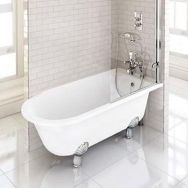 white bath with chrome fixtures and bath feet