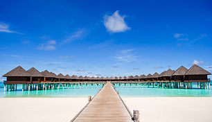 water-bungalows-and-wooden-jetty-on-mald