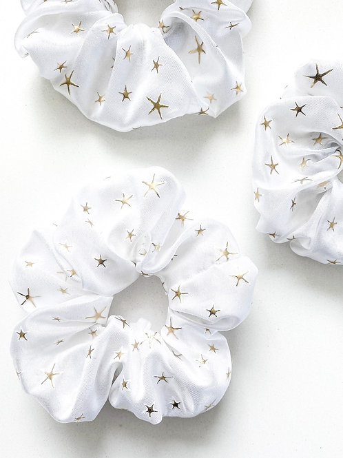 White satin with golden stars